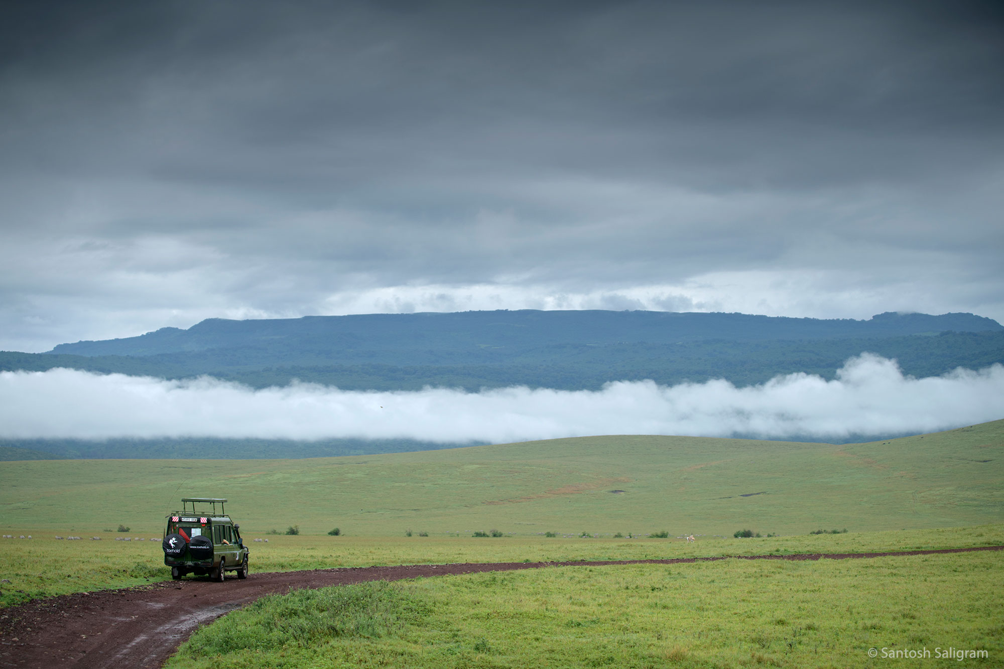 Toehold safari vehicle in Ngorongoro Crater, Tanzania, Santosh Saligram
