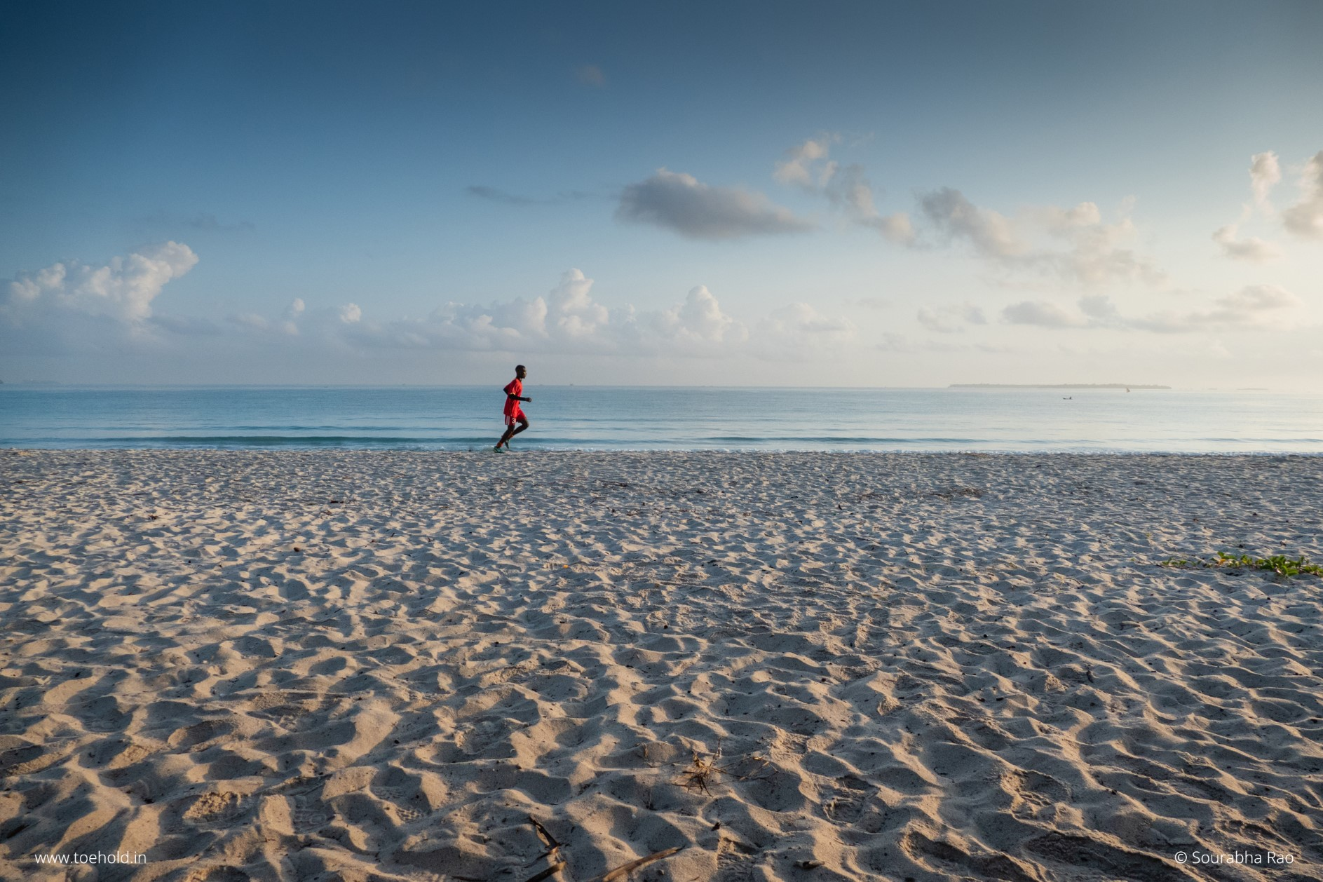 Man running on the beach, Tanzania
